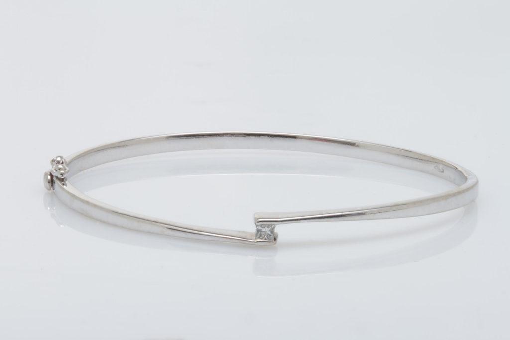 Jewelry Repair: 18k diamond bangle