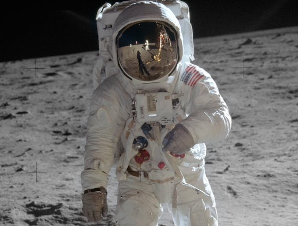 Buzz Aldrin with the Omega Speedmaster strapped around his wrist while on the moon