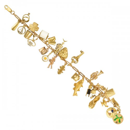 Assorted charm bracelet in 14k yellow gold. Length 7.5 inches.