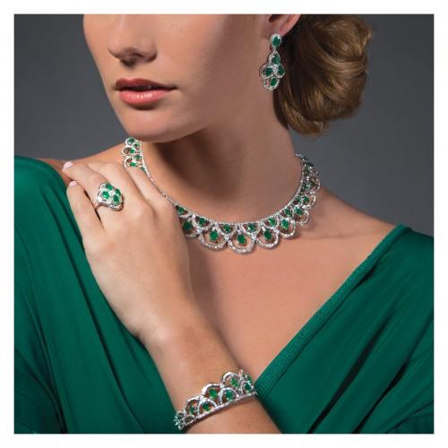 Emerald & diamond set in 18k white gold; ring, bracelet, necklace & earrings