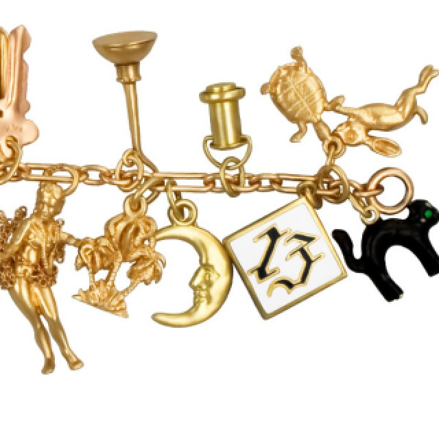 Assorted charm bracelet in mostly 14k (few charms are 10k) with key, heart, piano, moon, etc. image 2