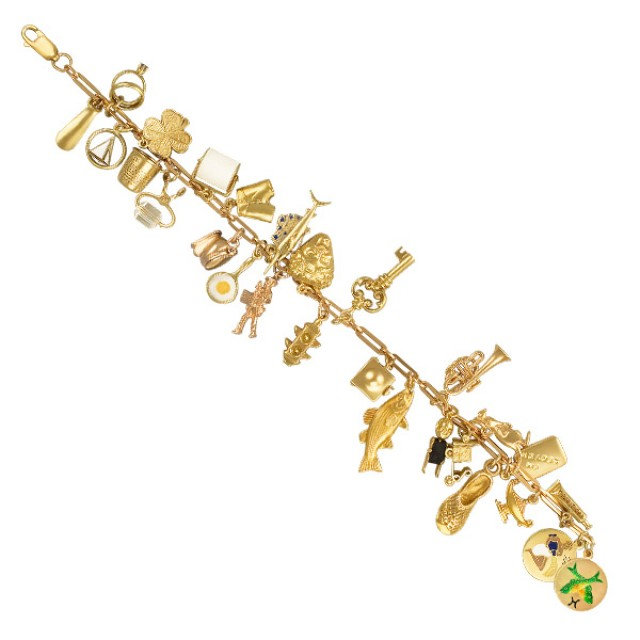 Assorted charm bracelet in 14k yellow gold. Length 7.5 inches. image 1