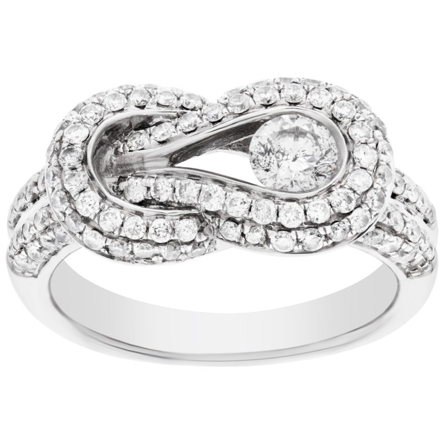 Diamond knot ring in 14k white gold. 0.25 cts center diamond. Size 5 image 1