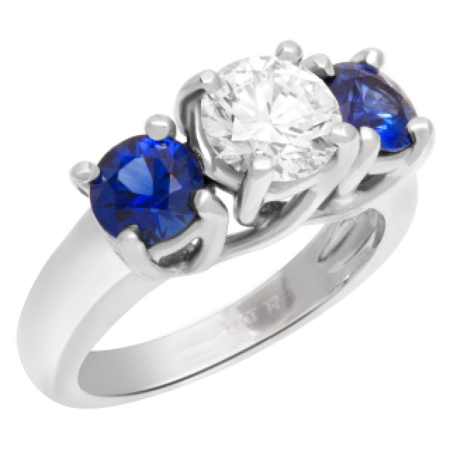 GIA certified round brilliant cut diamond 1.01 carat (H color, VS1 clarity) ring with 2 sapphires set in platinum. image 2