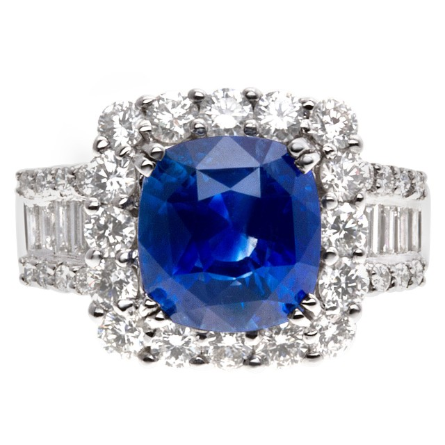 Sparkling 5.73 carat blue sapphire ring with diamond accents in 18k white gold image 1