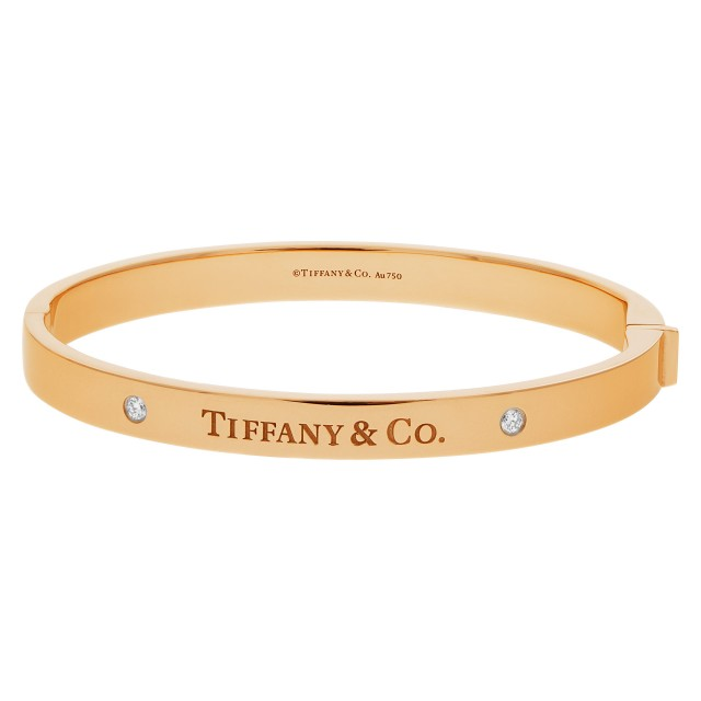Tiffany & Co. Hinged bangle with two diamonds in 18k yellow. Medium size image 1