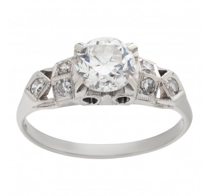 Charming diamond engagement ring in 18k white gold with an app. 0.60 carat center European cut round diamond