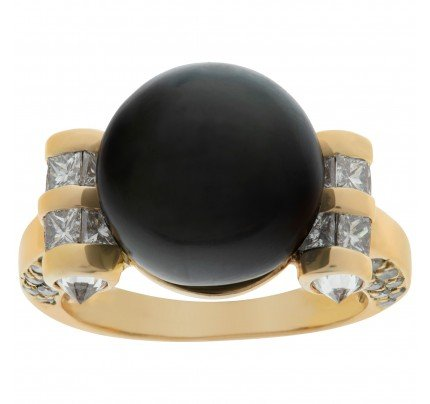 South Sea Pearl ring with diamond accents in 18k. 12.2 mm Pearl. 1.60 carats
