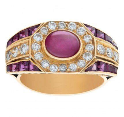 Cabochon ruby and diamond ring in 18k yellow gold. 0.50 carats in diamonds