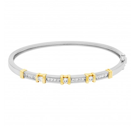 Diamond bangle in 14k white & yellow gold. 0.72 carats in diamonds