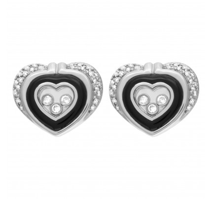 Heart shaped diamond earrings in 14k white gold w/ floating diamonds w/ approx. 0.80 cts in diamonds