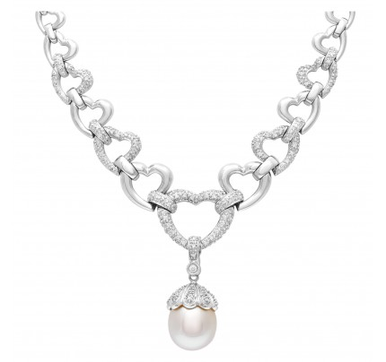 Elegant necklace in 14k white gold with diamond accents and 12mm pearl