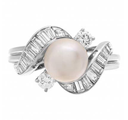 Pearl ring with diamond accents in platinum