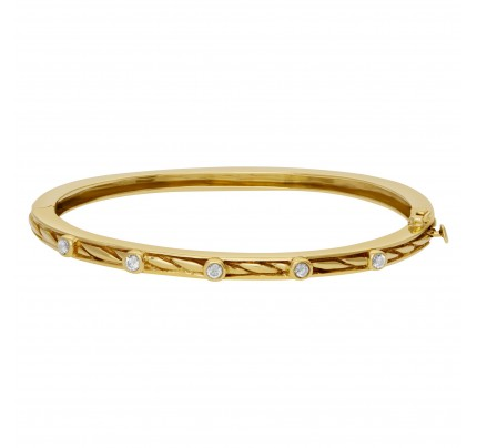 Bangle bracelet with 5 swirls in 14k yellow gold and diamonds