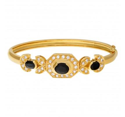 Diamond and sapphire bangle in 18k