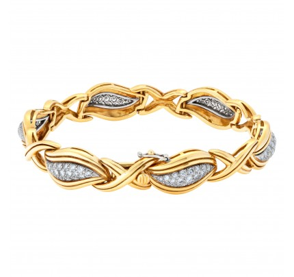 "Stylish ""Hugs & Kisses"" bracelet with over 3.50 carats full cut round brilliant diamonds set in 18K yellow gold."