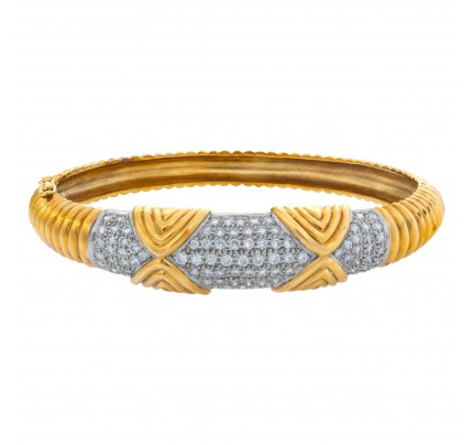 Diamond bangle in 18k yellow and white gold with approx. 4 carats in pave diamonds. Signed JT