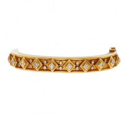 "Designer ""DORIS PANOS"" Etruscan revival style yellow gold bangle bracelet w/ approx. 1 carat total full cut round brilliant diamonds."