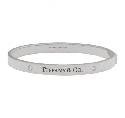 Tiffany & Co. Hinged Bangle bracelet in 18k White Gold with 2 Diamonds.